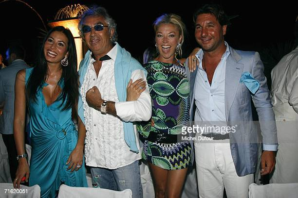 Flavio Briatore with Elisabetta Gregoraci and Tamara Beckwith attend the Fawaz Gruosi Birthday Party at the Billionhaire on August 8 2006 in Porto...