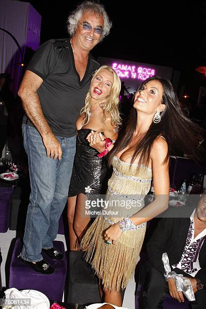 Flavio Briatore with Elisabetta Gregoraci and Valeria Marini attend the Fawaz Gruosi birthday party at the Billionaire on August 8 2007 in Porto...