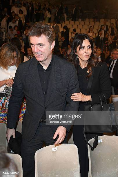 Flavio Cattaneo and Sabrina Ferilli attends a cocktail party ahead of Nastri D'Argento on July 2, 2016 in Taormina, Italy.
