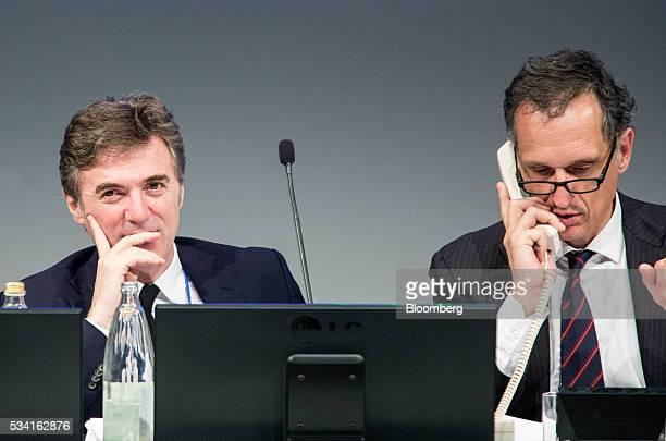 Flavio Cattaneo, chief executive officer of Telecom Italia SpA, left, looks on as with Giuseppe Recchi, chairman of Telecom Italia SpA, talks on a...