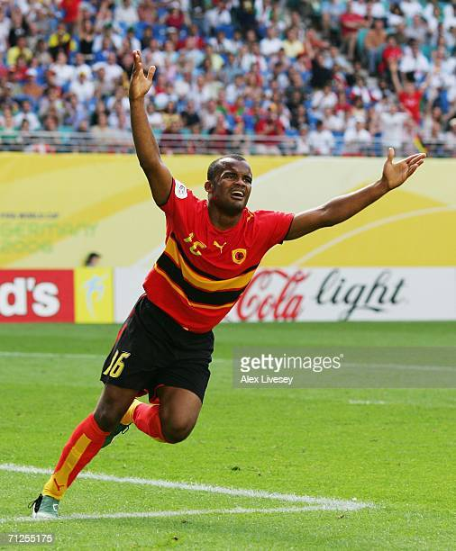 Flavio of Angola celebrates scoring the opening goal during the FIFA World Cup Germany 2006 Group D match between Iran and Angola played at the...