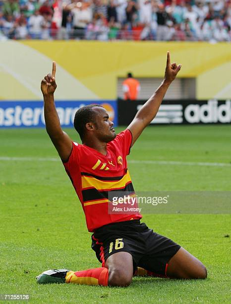 Flavio of Angola falls to his knees in celebration after scoring the opening goal during the FIFA World Cup Germany 2006 Group D match between Iran...