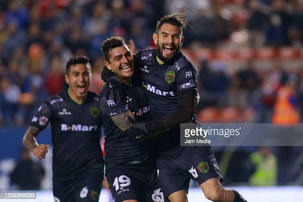 Flavio Santos of Juarez celebrates after scoring the second goal of his team during the 8th round match between Atletico San Luis and FC Juarez as...