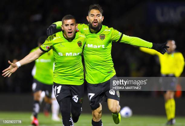 Flavio Santos of Juarez celebrates with teammate Mauro Fernandez after scoring a goal during the Mexican Clausura tournament football match between...