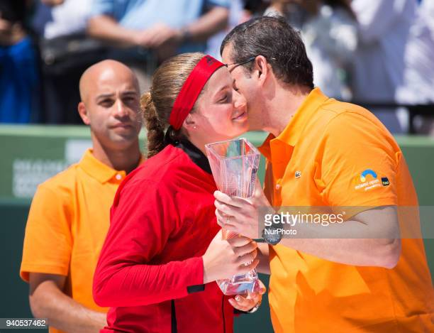 Flavio Souza Group Head of Wealth Management and services or Itau delivers the runner up Trophy to Jelena Ostapenko in Key Biscayne on March 31 2018