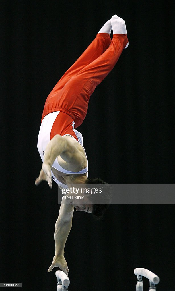 Flavius Koczi of Romania performs on the Parrell Bars during the mens senior qualification round, in the European Artistic Gymnastics Team Championships 2010, at the National indoor Arena in Birmingham, central England on April 23, 2010.