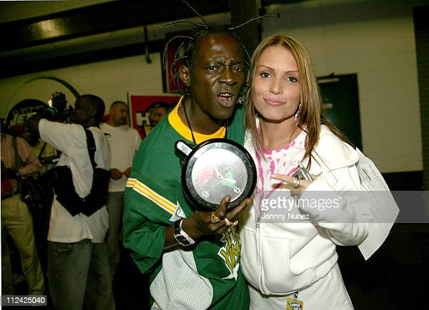 Flavor Flav and Angie Martinez during Hot 97 Summer Jam 2004 Backstage at Giants Stadium in New York City New York United States
