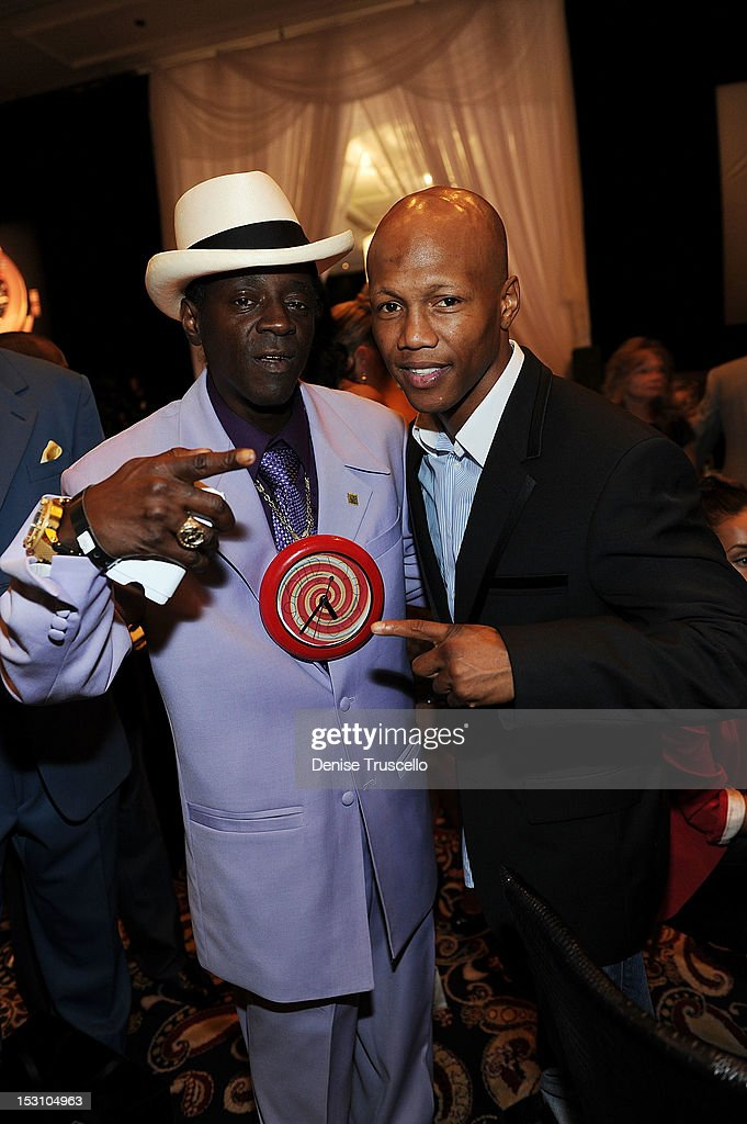 Flavor Flav and boxer Zab Judah attend 'A Legendary Evening With Hublot And WBC' at Bellagio Las Vegas on September 29, 2012 in Las Vegas, Nevada.