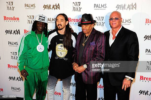 Flavor Flav DJ/producer Steve Aoki Joe Jackson and President and CEO of the Brenden Theatre Corp Johnny Brenden appear during the unveiling of a...