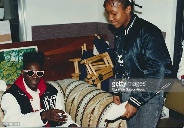Flavor Flav greeting fans backstage during the 1989 American Music Awards Los Angeles California January 30 1989