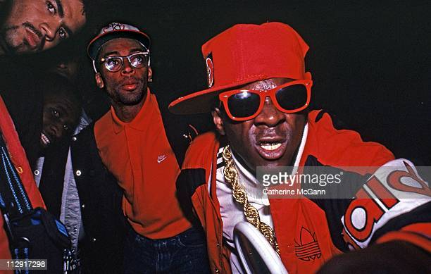 Flavor Flav of Public Enemy Spike Lee and unidentified pose for a photo at a party for the release of Run DMC's album 'Tougher Than Leather' on...