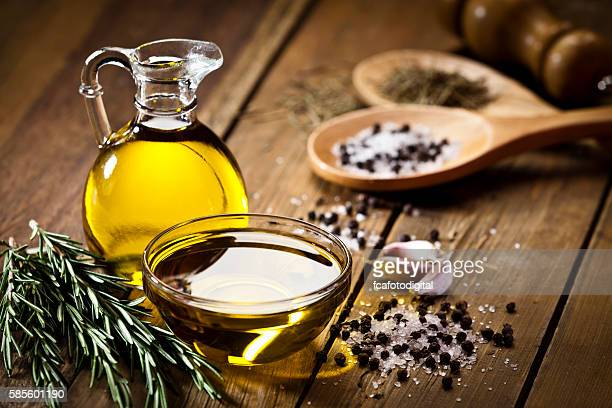 flavoring: olive oil, garlic, pepper, salt and rosemary - oil stock pictures, royalty-free photos & images