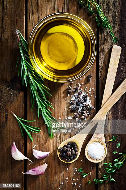 flavoring: olive oil, garlic, pepper, salt and rosemary - 調味料 ストックフォトと画像
