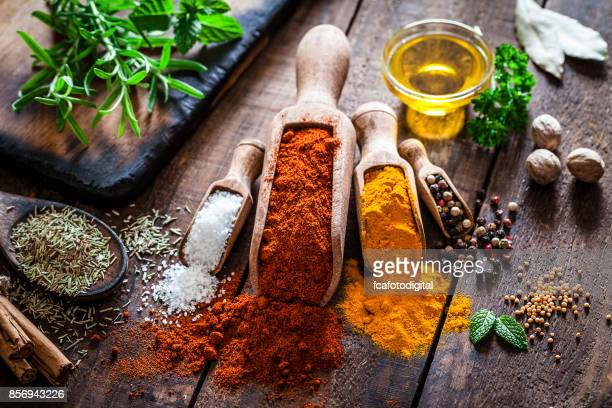 Flavoring: Spices and herbs on rustic wooden table