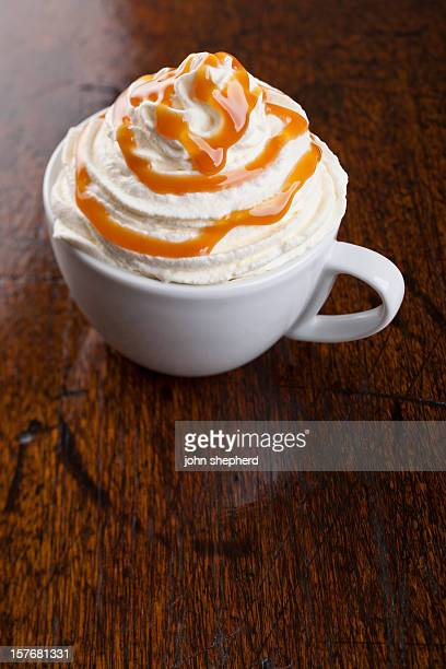 flavoured coffee topped with whipped cream and caramel sause - whipped food stock pictures, royalty-free photos & images