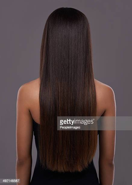 flawless hair thanks to her trusty flat iron! - black hair stock pictures, royalty-free photos & images