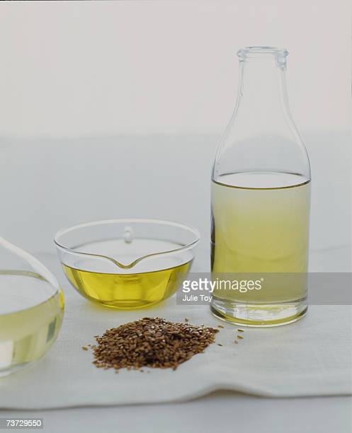 """""""flax seed oil and flax seeds, close-up"""" - flax seed stock pictures, royalty-free photos & images"""