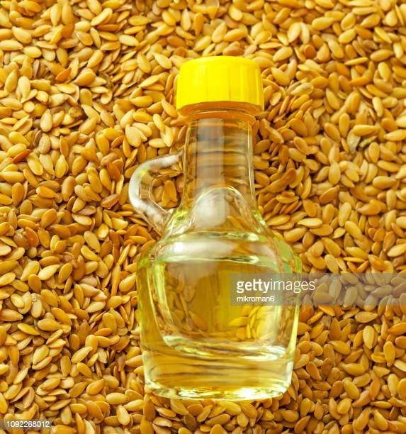 flax seed oil and golden flax seeds, close-up - flax seed stock pictures, royalty-free photos & images