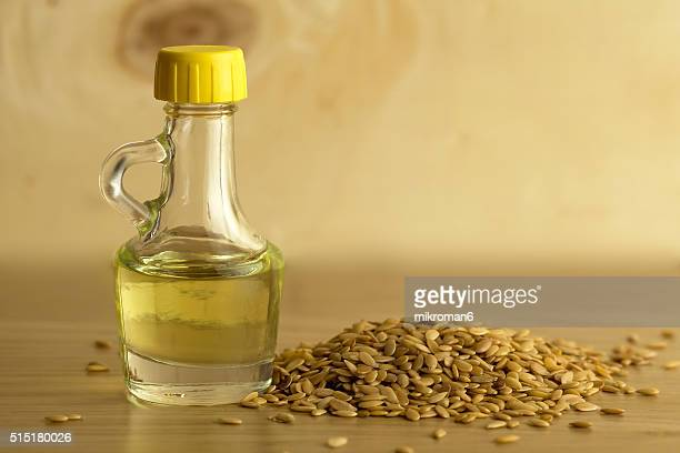 Flax seed oil and golden flax seeds, close-up