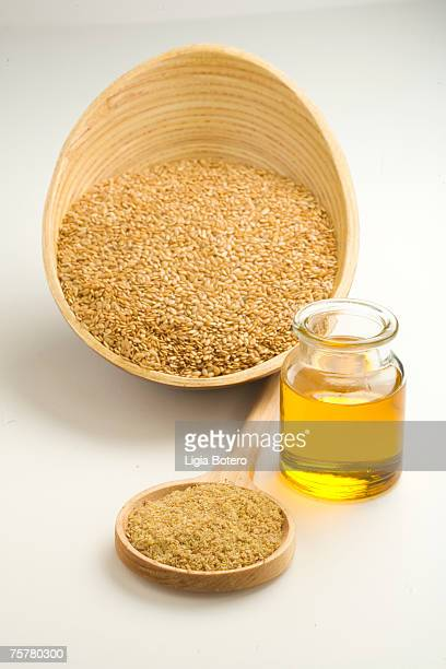 Flax seeds in bowl and flaxseed oil, studio shot