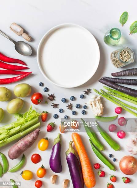 Flay lay fresh uncooked vegan food still life.