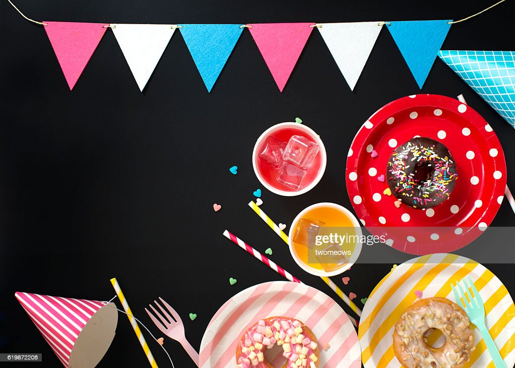 Flay lay kid's party items on black background. : Stock Photo