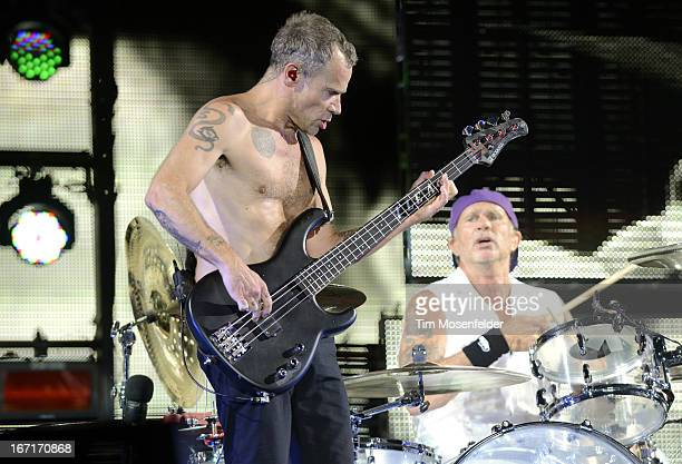 Flea and Chad Smith of the Red Hot Chili Peppers perform as part of the 2013 Coachella Valley Music Arts Festival at the Empire Polo Field on April...