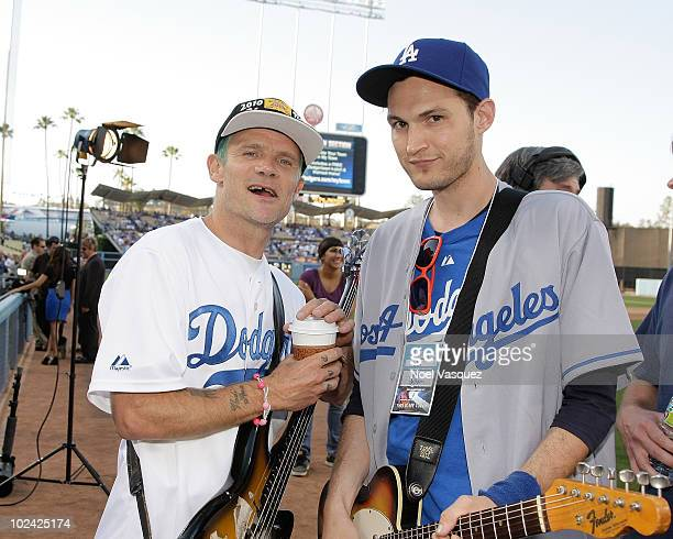 Flea and Josh Klinghoffer of the Red Hot Chili Peppers attend a game between the New York Yankees and the Los Angeles Dodgers at Dodger Stadium on...