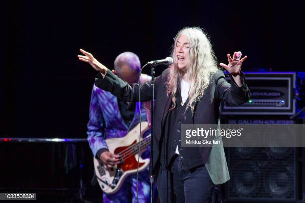 Flea and Patti Smith perform at Pathway To Paris event at The Masonic Auditorium on September 14, 2018 in San Francisco, California.