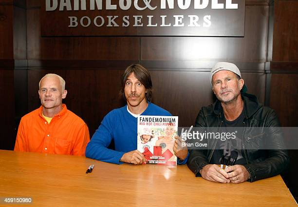 Flea Anthony Kiedis and Chad Smith of the Red Hot Chili Peppers sign copies of 'Fandemonium' at Barnes Noble bookstore at The Grove on November 17...