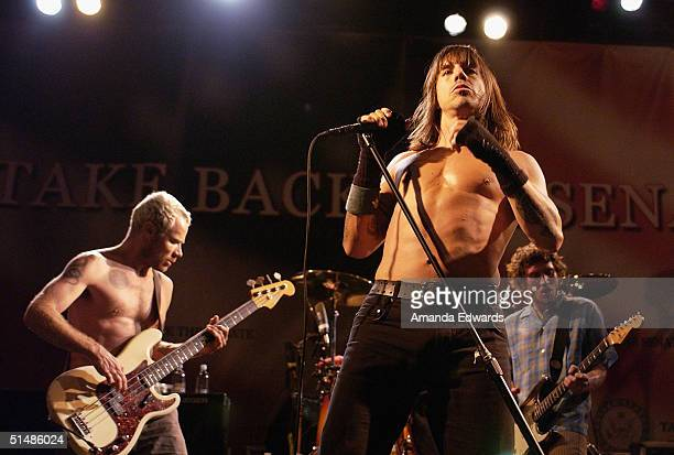Flea Anthony Kiedis and John Frusciante of The Red Hot Chili Peppers perform at a Democratic Senate fundraising concert on October 15 2004 at...