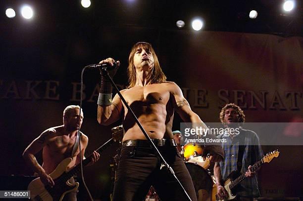 Flea Anthony Kiedis Chad Smith and John Frusciante of The Red Hot Chili Peppers perform at a Democratic Senate fundraising concert on October 15 2004...