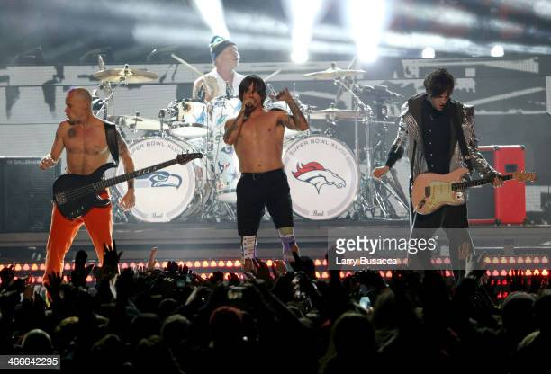 Flea Chad Smith Anthony Kiedis and Josh Klinghoffer of the Red Hot Chili Peppers perform during the Pepsi Super Bowl XLVIII Halftime Show at MetLife...