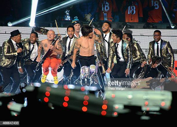Flea Chad Smith Anthony Kiedis Bruno Mars and Josh Klinghoffer perform during the Pepsi Super Bowl XLVIII Halftime Show at MetLife Stadium on...