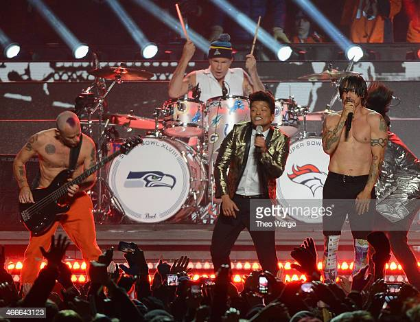 Flea Chad Smith Bruno Mars Anthony Kiedis and Josh Klinghoffer perform during the Pepsi Super Bowl XLVIII Halftime Show at MetLife Stadium on...
