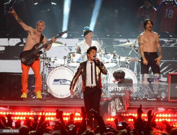Flea Chad Smith Bruno Mars Josh Klinghoffer and Anthony Kiedis perform during the Pepsi Super Bowl XLVIII Halftime Show at MetLife Stadium on...