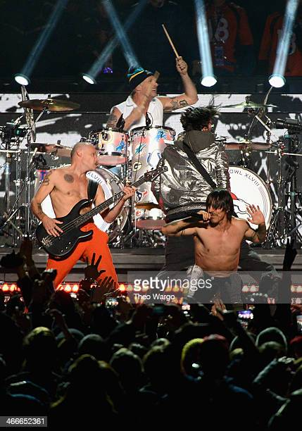Flea Chad Smith Josh Klinghoffer and Anthony Kiedis perform during the Pepsi Super Bowl XLVIII Halftime Show at MetLife Stadium on February 2 2014 in...