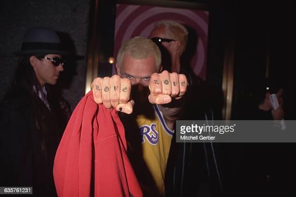 Flea has LOVE tattooed across both his knuckles