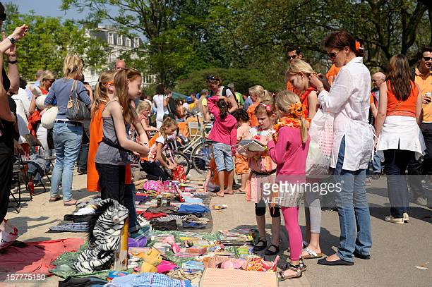 flea market for children in the vondelpark on queen's day - king's day netherlands stock pictures, royalty-free photos & images