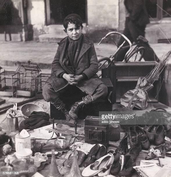 A flea market in Paris Ca 1950