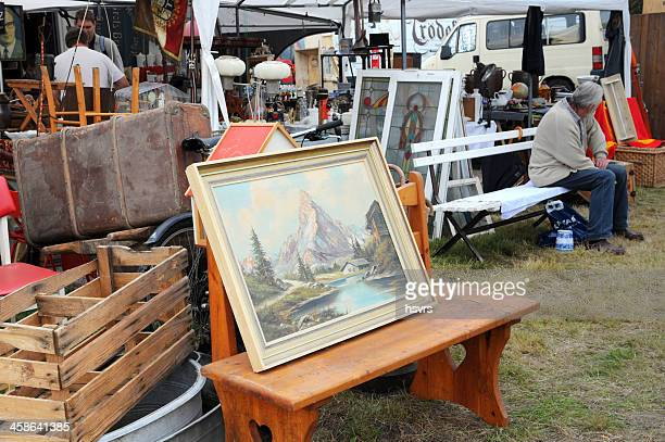 flea market with landscape image visitors in background - garage sale stock pictures, royalty-free photos & images