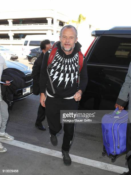 Flea of music band 'Red Hot Chili Peppers' is seen at 'Los Angeles International Airport' on February 01 2018 in Los Angeles California