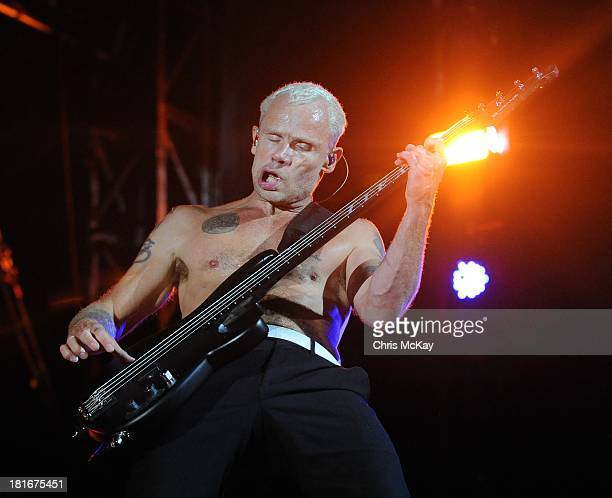 Flea of Red Hot Chili Peppers performs at the 2013 Music Midtown Festival at Piedmont Park on September 21 2013 in Atlanta Georgia