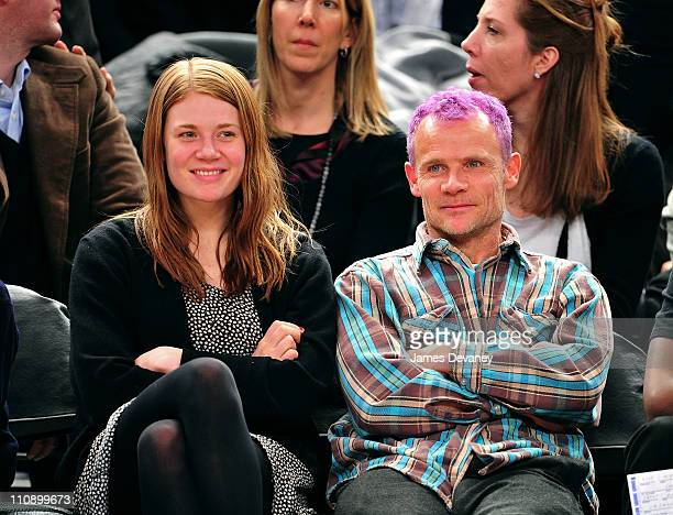 Flea of the Red Hot Chili Peppers and daughter Clara Balzary attend the Milwaukee Bucks vs New York Knicks game at Madison Square Garden on March 25...