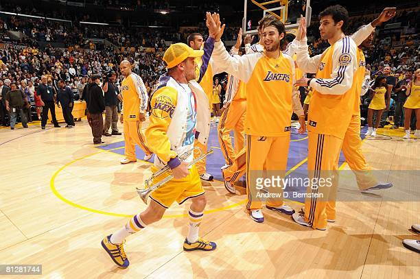 4b5af7cd03b Flea of the Red Hot Chili Peppers highfives Sasha Vujacic of the Los  Angeles Lakers after