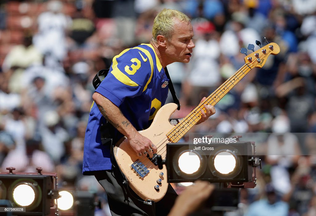 Flea of the Red Hot Chili Peppers performs before the Los Angeles Rams home opening NFL game against the Seattle Seahawks at Los Angeles Coliseum on September 18, 2016 in Los Angeles, California.
