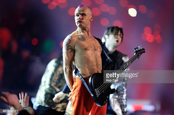 Flea of the Red Hot Chili Peppers performs during the Pepsi Super Bowl XLVIII Halftime Show at MetLife Stadium on February 2 2014 in East Rutherford...