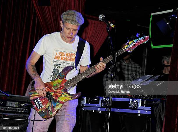 Flea performs at the launch of Flea and Damien Hirst's new line of Spin Bass Guitar at Club Nouveau in Mayfair's The Arts Club on November 8 2011 in...