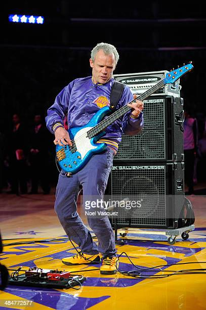 Flea performs the national anthem at a basketball game between the Memphis Grizzlies and the Los Angeles Lakers at Staples Center on April 13 2014 in...