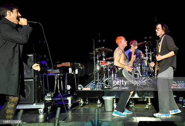FleaAnthony KiedisChad SmithJosh Klinghoffer of the Red Hot Chili Peppers performs at Malibu Love Sesh Benefit Concert for victims of the Malibu...